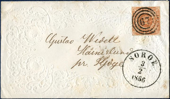 "Ladies envelope with embossed ornamention sent from Sorøe to Kjøge on 3 February 1856 bearing a 4 sk. 1854-issue tied by numeral ""67"" alongside CDS ""SORÖE 3/2 1856"". Decorated letter sheet included. Rare in this condition."