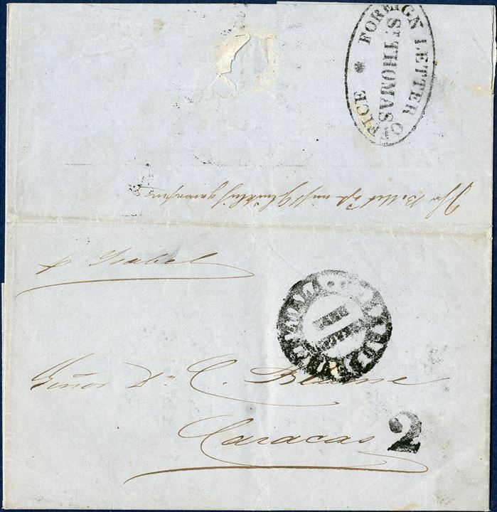 "Entire dated St. Thomas 14. September 1855 to Caracas, Venezuela. Sent through and stamped with ""FOREIGN LETTER OFFICE - ST. THOMAS"" on reverse. Routing instruction ""pr. Isabel"", Venezuelan receiving mark struck on front and charged ""2"" reales due by addressee. Merchants in St. Thomas maintained the office from 1846 to 1860. Mail was bagged and shipped by private packets to avoid high charges of inconvenient schedules."