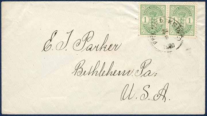 "Printed matter envelope from Frederiksted 23 September 1900 to Bethlehem, USA. Pair of Coat-of-Arms 1¢ tied by CDS ""FREDERIKSTED 23/9 1900"". Rate 2¢ from 1.4.1879 – 31.12.1901."