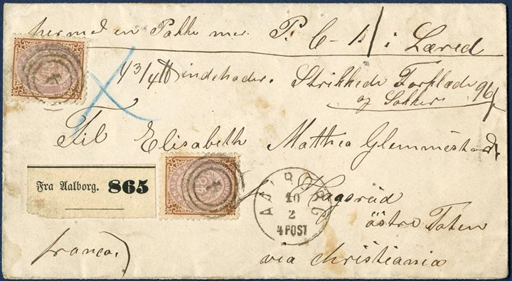 "Parcel letter sent from Aalborg 10 February 1871/72 to Hagerud via Christiania, Norway. Two 48 sk. bicolored issue tied by numeral 4, CDS lapidar IIa-1 ""AALBORG 10/2 4 POST"". Parcel label ""Fra Aalborg. 865"", one parcel 4 3/4 . Letter 8 sk. plus, parcel rate 8 sk. plus 16 sk. for each of the 5 , = 96 sk. Very few such impressive 48 sk. letters known, and the purple colour of the stamps are far better than what to expect of this stamp."
