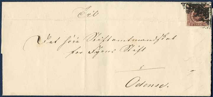 Local letter from Fyns Stiftamtsstue dated 10 July 1852 to Odense. Postage paid with 4 RBS Thiele I (envelope folded through stamp), tied and cancelled with what I believe what has happened, is that the clerk has taken the cover, flipped it over and then pressed the corner with the stamp onto the ink pad. I have never seen similar way of cancelling in the past. A most unusual method of cancellation.