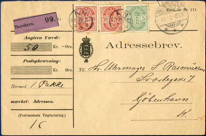 Insured Parcel from suboffice Sand via Thorshavn 21 September 1904 to Copenhagen, Denmark. Insured value 50 kr. for 1 parcel weighing 1 pound, Thorshavn. 99 purple label, two 10 øre red and 5 øre green Coat of Arms issue tied collecting office star-cancel SAND alongside Swiss-type THORSHAVN 21.-9.-1904 with Copenhagen receiving mark 29 September 1904 on reverse.
