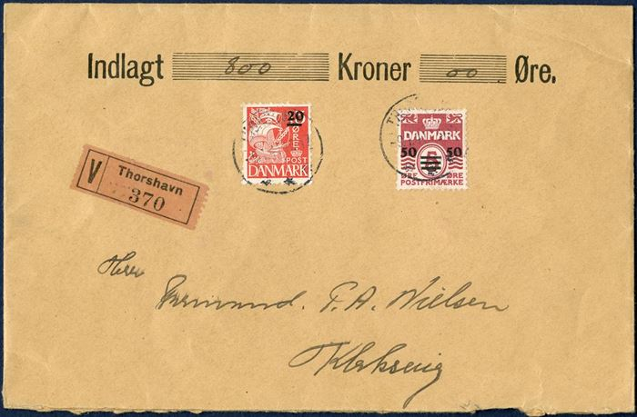 "Insured letter with 800 kr. sent from Thorshavn 9 January 1941 to Klaksvig. Provisional issue 50/5 and 20/15 øre tied with THORSHAVN -9.4.1941 16-17, value label ""V Thorshavn 370"". Letter sent from Folmer Østergaaard with salary payment to construction workers. 20 øre letter rate plus 50 øre insured fee up to 1000 kr."