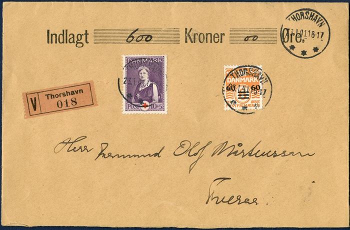 "Insured letter with 600 kr. sent from Thorshavn 23 January 1941 to Tveraa. Provisional issue 60/6 and 10+5 øre Queen Aleksandrine tied with THORSHAVN 23.4.1941 16-17, value label ""V Thorshavn 018"". Letter sent from Folmer Østergaaard with salary payment to construction workers. 20 øre letter rate plus 50 øre insured fee up to 1000 kr."