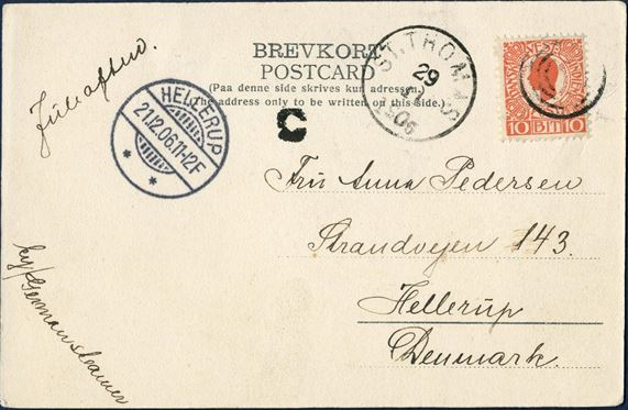 Postcard from Christiansted 29 november 1906 to Hellerup, Denmark. 10 BIT red I. printing King Christian IX tied by 4-ring cancel without dot used at St. Thomas for arriving shipmail from Christiansted and origin mark C large type struck on front, with ST THOMAS 29/11 1906 LAP on front. Instruction to the post JULEAFTEN for delivery Christmas evening and routing instruction BY/GERMAN STEAMER. UPU postcard rate 10 BIT from 15.7.1905 – 31.12.1909.