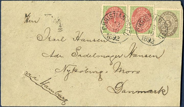 "Envelope from Christianssted 13 October 1892 to Nykøbing Mors, Denmark. 7¢ direct rate to Denmark and Germany only with routing instruction VIA HAMBURG, bearing bicolored 5¢ IV and pair 1¢ VII printing tied by mute datestamp with two SS ""CHRISTIANSSTED 13/10 1892"", with St. Thomas transit and NYKJØBING I JYLL. 25/11 receiving mark on reverse, envelope opened at right and shortened a bit. VERY FEW 7¢-rate letters recorded with direct ship to Germany or Denmark, the most sought after postal rate from Danish West Indies."