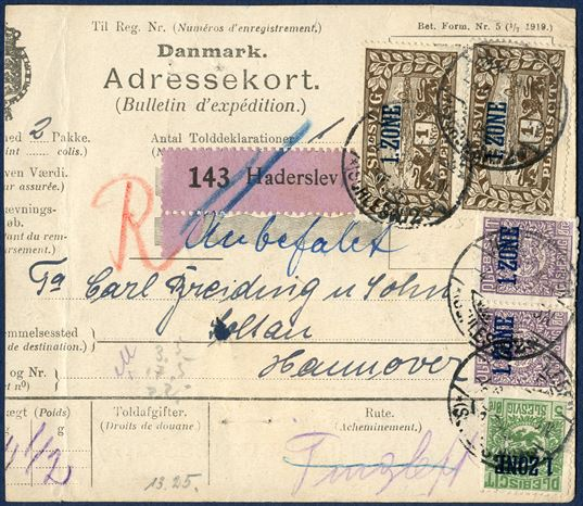 Danish parcel card for two parcels from Haderslev 4 June 1920 to Soltau, Hannover, Germany. 5 Øre, pair 40 øre and two 1 Kr. 1. ZONE Plebiscit Slesvig, total franking 2,85 Kr. Purple value label without value '143 HADERSLEV', red crayon 'R'. Parcels weighing 11,5 Kg. Parcel fee 0-5 kg 60 øre, 5-11,5 kg, = + 6,5 kg. rounded up to 7 kg. with each kg. at 30 øre = 210 øre, registration fee 15 øre, total 285 øre, correct franking, minor faults on some stamps.