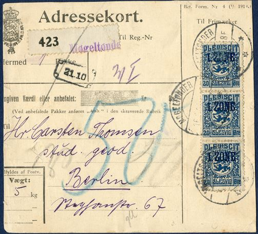 Danish parcel card (cut down) from Møgeltønder 16 June 1920 to Berlin, Germany. Three 20 øre 1. ZONE Plebiscit Slesvig tied by datestamp LØGUMKLOSTER 16.6.20 6-8F. White numbered label '423' and stamped 1-line 'Møgeltønder', parcel weighing 5 Kg., parcel fee 0-5 kg 72 øre according to the Danish 'Post- og Rejsehåndbog von 10.12.1919 s. 54', underfranked 12 øre and not charged. '50' blue crayon which apparently is customs duties.