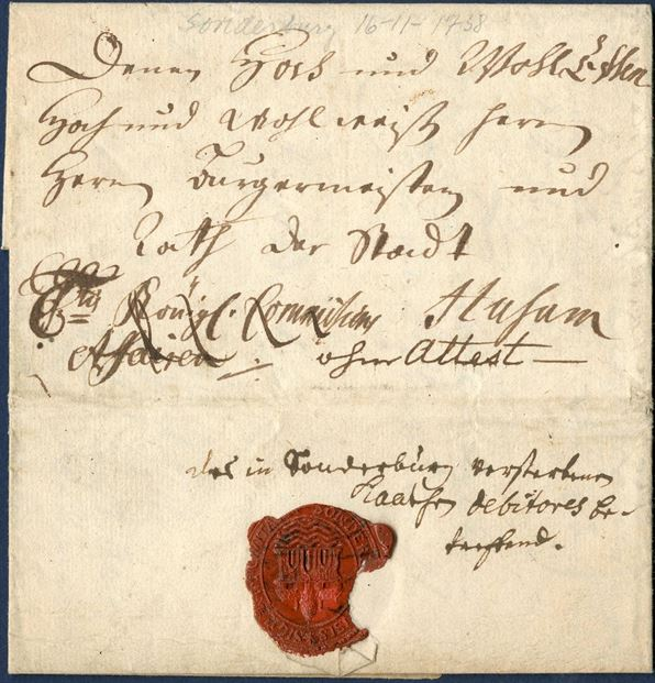 Royal Service letter from Sonderburg 16 November 1738 to Husum with Sonderborg city wax seal. Front with Royal insignia - C6tus Königl. Commission Affairer ·/· and noted – ohne Attest – and crossed out; Königl. Commission Affairer. It is thought, that Husum sent a letter so that Sonderburg had to pay postage since Sonderburg is writing the following inside the letter; 6-tus setzen zu lassen, damit es an porto keine Kostern verursachen möge. Likely only recorded with reference to Royal Insignia letter was not charged. Illustrated in ARGE SCH 163.VII-VIII.