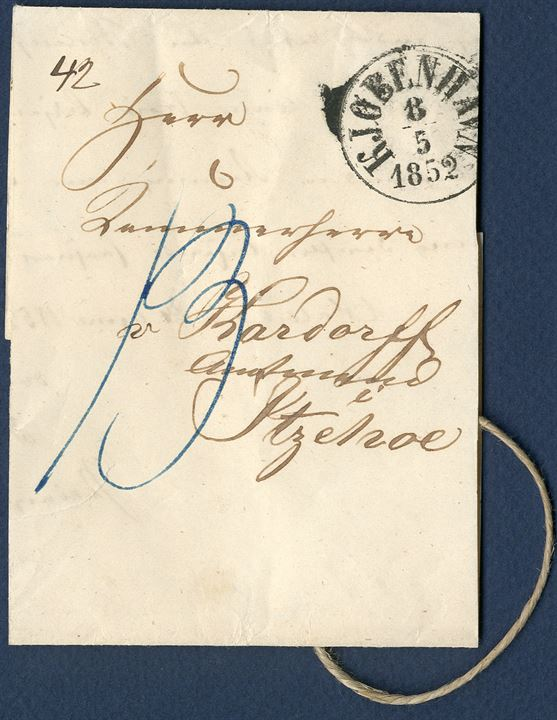 Wrapper from Copenhagen 8 May 1852 to Itzehoe, Holstein, Germany. Cord tied with red wax seal 'Brødrene / Berling', a newspaper publisher in Copenhagen. Rate '42' Rbs noted and blue ink '13' 13 Lbs due by addressee. Rate 27.2.1851 - 31.6.1853: 1 Lÿbsk sk. per sheet ( 5 Lbs = 16 Rbs., (C.C. no. 2/1851, section A, no. 2).