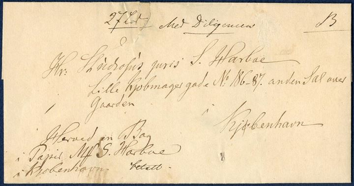 "Parcel letter for a book sent to Copenhagen weighing 27 lod. On the front endorsed ""Med Diligencen"" with mail coach, very scarce endorsement on Danish letters (1850 ?)"