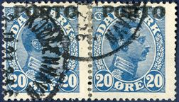 20 øre postage due stamp in pair with TWO IMPRESSION's of the overprint PORTO shifted 0,2 mm vertically, cancelled with Copenhagen cds 2. November 1921. The stamps have been joined with hinges and originally formed an integrated pair. The right stamp with one short perforation tooth. An extremely rare variety of Danish philately.