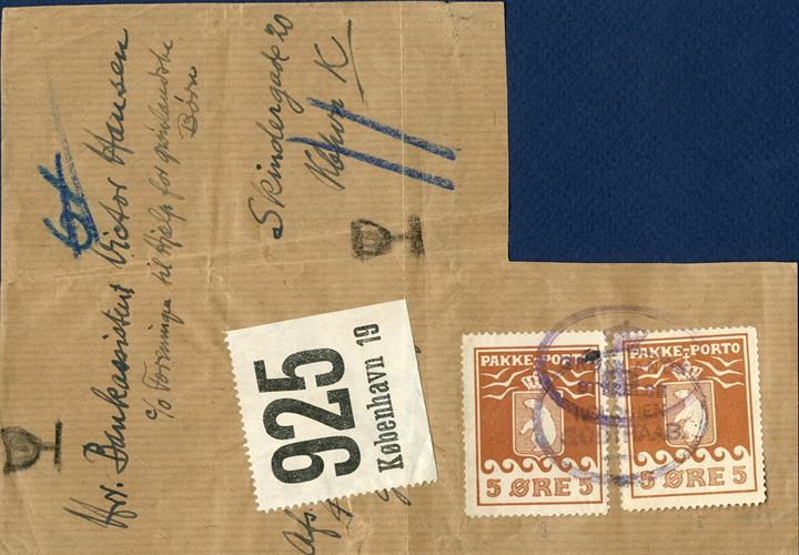"1936-1938. Large piece from parcel wrapping with two 5 øre 1918 and 1924 issue Pakke-Porto stamps apllied and cancelled with the oval mark ""KOLONIEN GODTHAAB"" 1921-38 and on arrival in Copenhagen cancelled ""GRØNLANDS STYRELSE"" 1931-38, but incomplete franking. Parcel registration no. 924, Kbh 19, ""fragile"" parcel and with the entire addressee kept intact. Only a few such pieces recorded."