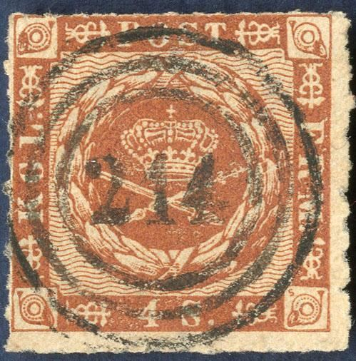4 sk. 1863 wavy-line spandrels issue rouletted issue, with a superb numeral strike 214 Pelworm - One of the most sought after and perhaps even less than 5 known on Danish stamps. Superb quality and this is probably the finest known on the 4 sk. 1863 rouletted issue.