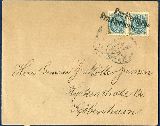 "Letter from Faroe Island to Copenhagen (+/- 1900). Pair 4 øre bicolored perforation 12 3/4 cancelled twice with 1-line mark ""Fra Færöerne"" in Copenhagen."