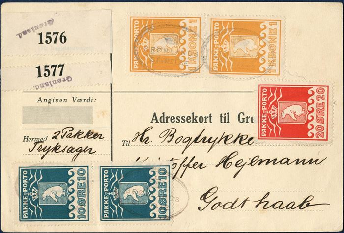 "Parcel card to Hejlmann, Godthaab. Two 10 øre 1915 IV printing, 20 øre VII printing 1915 and two 1 kr. 1930 (AFA 7, 9, 11) tied by oval mark ""GRØNLANDS STYRELSE"" in black, GF1, no. 21.00). Two PRINTED MATTER parcels weighing each 5-10 kg, 120 øre per parcel 1931-rate, correct 240 øre franking. Sent with ""Disko"" from Copenhagen 6 October 1933. Parcel card ""Form. Ah. 57019"" GF13."