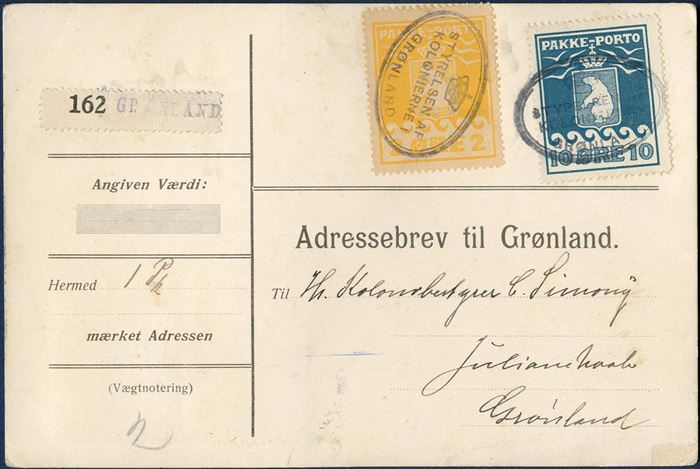 "Parcel card to C. Simony, Julianehaab. 1 øre II printing on reverse, 2 øre II printing and 10 øre I printing (AFA 4,5,7) tied by ""STYRELSEN AF KOLONIERNE I GRØNLAND"" cachet GF14.01. 14 øre franking for 7 kilos, 1 øre per 0,50 kg., registration label type B, no. 162 type b. Sent with ""Fox"" 10 June 1922 from Copenhagen. 1 øre with some short perforations."