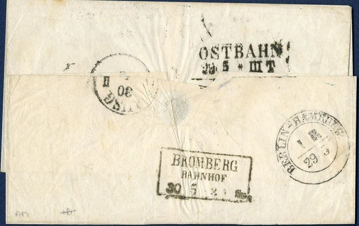 "Letter sheet sent from Copenhagen 28 May 1852 to Berlin. Prepaid ""26"" sk. marked upper right corner, convention transit mark ""Aus Daenemarck d. Mecklenburg"" in black struck on front and on reverse transit marks ""OSTBAHN 29.5 – III T."", two-ring ""BERLIN-HAMBURG 29 5"" and boxed ""BROMBERG / BAHNHOF / 30 5""."